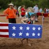 Photo -  Kye Sparks, 9, helps carry Flag Boat before the family's fourth Cardboard Boat Regatta as part of the LibertyFest events at Arcadia Lake. PHOTO BY BRYAN TERRY, THE OKLAHOMAN  <strong>Bryan Terry -  THE OKLAHOMAN </strong>