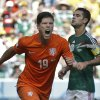 Netherlands\' Klaas-Jan Huntelaar celebrates after scoring his side\'s second goal during the World Cup round of 16 soccer match between the Netherlands and Mexico at the Arena Castelao in Fortaleza, Brazil, Sunday, June 29, 2014. The Netherlands won the match 2-1. (AP Photo/Natacha Pisarenko)