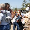 Photo - Randy Thomas District 2 Pottawatomie County Board of Commissioners hugs Oklahoma State football player James Castleman after thanking him for helping clear debris ,Wednesday, June 12, 2013, in Bethel Acres, Okla. Photo by Sarah Phipps, The Oklahoman