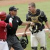 Oklahoma\'s Cody Reine and Missouri\'s Ben Turner are separated by the home plate umpire during the Big 12 baseball championship game between the University of Oklahoma and Missouri at the Chickasaw Bricktown Ballpark in Oklahoma City, Sunday, May 27, 2012. Photo by Sarah Phipps, The Oklahoman.