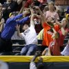 Photo - Pittsburgh Pirates' Josh Harrison (5) can't catch a home run ball hit by Arizona Diamondbacks' Andy Marte during the sixth inning of a baseball game, Thursday, July 31, 2014, in Phoenix. (AP Photo/Matt York)