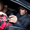 "Photo - Clarence Seedorf signs an AC Milan jersey upon his arrival at Linate's airport, in Milan, Italy, Wednesday, Jan. 15, 2014. Seedorf said he will take over as the new coach at AC Milan, replacing Massimiliano Allegri who was fired the day before. Seedorf made the announcement at Brazilian club Botafogo, where he has been playing. ""The next step for me is as the coach of Milan,"" Seedorf told reporters. AC Milan told The Associated Press that the club's former midfielder had yet to sign a contract, but added that he was expected to arrive in Italy on Thursday. The 37-year-old Dutchman won the Champions League twice with AC Milan, and also won Europe's top club title with Ajax and Real Madrid. (AP Photo/Davide Spada, LaPresse)"