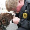 Photo - DOG RESCUE: Webbers Falls Police Chief Tim Brown (blondish hair) is fond of the town's newly adopted dog