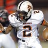 Putnam City\'s Devin White scrambles during the high school football game between Moore and Putnam City at Westmoore High School, Thursday, Oct. 4, 2012. Photo by Sarah Phipps, The Oklahoman