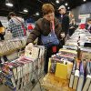 Linda McCormack places a book in her shopping cart, already full of books. McCormack drove to the sale from Granite. She said her first sale was five years ago and she knew then she was