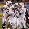 Stanford cornerback Terrence Brown (6) celebrates his interception with his teammates against Oklahoma State during the first half of the Fiesta Bowl NCAA college football game Monday, Jan. 2, 2012, in Glendale, Ariz. (AP Photo/Matt York)