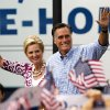Photo -   Republican presidential candidate and former Massachusetts Gov. Mitt Romney, right, waves as he arrives with his wife Ann at a campaign rally, Sunday, Oct. 7, 2012, in Port St. Lucie, Fla. (AP Photo/Lynne Sladky)