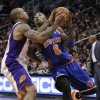 New York Knicks\' J.R. Smith (8) drives against Phoenix Suns\' Shannon Brown during the first half of an NBA basketball game on Wednesday, Dec. 26, 2012, in Phoenix. (AP Photo/Matt York)