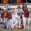 Oklahoma\'s James Hanna (82) runs in for a touchdown at Oklahoma State\'s Andrew McGee (6) chases him during the Bedlam college football game between the University of Oklahoma Sooners (OU) and the Oklahoma State University Cowboys (OSU) at Boone Pickens Stadium in Stillwater, Okla., Saturday, Nov. 27, 2010. Photo by Sarah Phipps, The Oklahoman