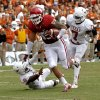 OU\'s Trey Millard (33) runs past UT\'s Mykkele Thompson (2) and Demarco Cobbs (7) during the Red River Rivalry college football game between the University of Oklahoma (OU) and the University of Texas (UT) at the Cotton Bowl in Dallas, Saturday, Oct. 13, 2012. Photo by Chris Landsberger, The Oklahoman