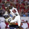 Westmoore\'s Dahu Green catches the ball over Southmoore\'s Reginald Dantzler Jr. during their high school football game in Moore, Okla., Friday, Sept. 13, 2013. Photo by Bryan Terry, The Oklahoman