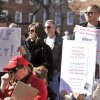 Protesters hold up signs during a protest against Governor Martin O\'Malley\'s new gun control legislation at Lawyers Mall in Annapolis, Saturday, Jan. 19, 2013. Rallies are being held by gun rights advocates four days after President Barack Obama unveiled a sweeping plan to curb gun violence. (AP Photo/Capital Gazette, Matthew Cole)