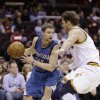 Minnesota Timberwolves\' Luke Ridnour (13) drives past Cleveland Cavaliers\' Luke Walton (4) during the second quarter of an NBA basketball game Monday, Feb. 11, 2013, in Cleveland. Ridnour scored a team-high 21 points for Minnesota\'s 100-92 win. (AP Photo/Tony Dejak)