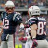 Photo -   New England Patriots quarterback Tom Brady (12) fist-bumps wide receiver Wes Welker (83) after they connected for a touchdown against the Denver Broncos in the first quarter of an NFL football game, Sunday, Oct. 7, 2012, in Foxborough, Mass. (AP Photo/Steven Senne)