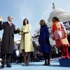 Photo - INAUGURATION / PRESIDENT / SWEARING IN / MICHELLE OBAMA / SASHA OBAMA / MALIA OBAMA / FAMILY: Barack Obama, left, takes the oath of office from Chief Justice John Roberts, not seen, as his wife Michelle, holds the Lincoln Bible and daughters Sasha, right and Malia, watch at the U.S. Capitol in Washington, Tuesday, Jan. 20, 2009. (AP Photo/Chuck Kennedy, Pool) ORG XMIT: DCJE133