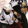 Photo - Phoenix Coyotes' Kyle Chipchura, right, fights with Los Angeles Kings' Daniel Carcillo during the second period of an NHL hockey game, Tuesday, Oct. 29, 2013, in Glendale, Ariz. (AP Photo/Matt York)
