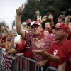 OU fans cheer as the team bus arrives before the Red River Rivalry college football game between the University of Oklahoma Sooners and the University of Texas Longhorns at the Cotton Bowl Stadium in Dallas, Saturday, Oct. 12, 2013. Photo by Bryan Terry, The Oklahoman