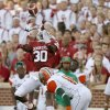 Oklahoma\'s Javon Harris (30) intercepts a pass intended for Florida A&M\'s Anthony Williams (11) during the college football game between the University of Oklahoma Sooners (OU) and Florida A&M Rattlers at Gaylord Family—Oklahoma Memorial Stadium in Norman, Okla., Saturday, Sept. 8, 2012. Photo by Bryan Terry, The Oklahoman