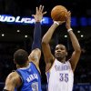 Oklahoma City\'s Kevin Durant (35) shoots against Dallas\' Shawn Marion (0) during an NBA basketball game between the Oklahoma City Thunder and the Dallas Mavericks at Chesapeake Energy Arena in Oklahoma City, Sunday, March 16, 2014. Photo by Nate Billings, The Oklahoman