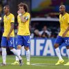 Photo - Brazil's Fernandinho, David Luiz and Maicon, from left, walk over the pitch after Germany scored their fifth goal during the World Cup semifinal soccer match between Brazil and Germany at the Mineirao Stadium in Belo Horizonte, Brazil, Tuesday, July 8, 2014. (AP Photo/Frank Augstein)