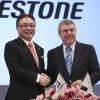 International Olympic Committee (IOC) President Thomas Bach, right, and Bridgestone Corp. CEO Masaaki Tsuya pose for photographers during a press conference in Tokyo, Friday, June 13, 2014. Japanese tire manufacturer Bridgestone signed an agreement on Friday to become a top-tier sponsor of the IOC in a 10-year deal that will cover the 2020 Tokyo Games. Bridgestone officials declined to reveal financial terms of the deal but the Asahi Shimbun newspaper reported that Bridgestone will pay $344 million to become a worldwide sponsor under the IOC\'s global commercial program, known as TOP. (AP Photo/Koji Sasahara)
