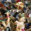 Minnesota Lynx guard Lindsay Whalen looks to shoot against San Antonio Stars guard Becky Hammon (25) during the first half of a WNBA basketball game, Friday, July 25, 2014, in Minneapolis. (AP Photo/Stacy Bengs)