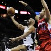 San Antonio Spurs\' Tony Parker, left, of France, shoots over Los Angeles Clippers\' Blake Griffin during the first half of an NBA basketball game, Monday, Nov. 19, 2012, in San Antonio. (AP Photo/Darren Abate)
