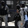 Police officers escort a man into court to appear on terrorism charges in connection with the killing of five men last month, in Skopje, Macedonia, Wednesday, May 2, 2012. Macedonian authorities arrested some 20 radical Islamists, suspected in the murder of five Macedonian fishermen last month which fueled ethnic tensions in this tiny Balkan country. (AP Photo/Boris Grdanoski)