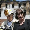 Photo - Middlesex County District Attorney Marian Ryan speaks at a news conference as Lowell Fire Chief Edward Pitta listens, at left, outside a burned three-story apartment and business building in Lowell, Mass., Thursday, July 10, 2014. Officials said four adults and three children died in a fast-moving pre-dawn fire. (AP Photo/Elise Amendola)