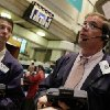 Photo -   Traders Todd Ingrilli, left, and Jonathan Niles work on the floor of the New York Stock Exchange Monday, June 18, 2012. U.S. stocks are falling after the opening bell as Europe's debt crisis roils markets despite the victory of a pro-Europe party in Greek elections. (AP Photo/Richard Drew)