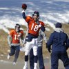 Photo - Denver Broncos quarterback Peyton Manning (18) throws a pass during NFL football practice at the team's training facility in Englewood, Colo., on Thursday, Jan. 23, 2014. The Broncos are scheduled to play the Seattle Seahawks in Super Bowl XLVIII on Feb. 2. (AP Photo/Ed Andrieski)
