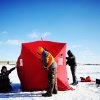 Despite subzero wind chill temperatures, from left, Josh Anderson, 12, Jake Anderson, 14, and Marshal McGovern, 13, all of Sioux Falls, S.D., set up a portable fish house before doing some ice fishing at Family Park in Sioux Falls on Sunday, Jan. 5, 2014. Monday's temperatures in Sioux Falls are expected to see a low of minus 20 degrees, an expected high of minus 13 degrees and wind chills possibly dipping below minus 40, according to National Weather Service Meteorologist Philip Schumacher. According to National Weather Service records, the last time Sioux Falls saw wind chills approaching minus 50 was in 1997. (AP Photo/Argus Leader, Joe Ahlquist)