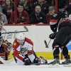 Photo - Carolina Hurricanes' Riley Nash (20) shoots against  Florida Panthers' Dmitry Kulikov (7), of Russia, and goalie Tim Thomas during the first period of an NHL hockey game in Raleigh, N.C., Friday, Feb. 7, 2014. Nash scored on the shot. (AP Photo/Gerry Broome)