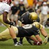 Colorado\'s Jordon Dizon (44) and Justin Drescher (70) recover a fumble by Oklahoma\'s Reggie Smith (3) on a kick return during the second half of the college football game between the University of Oklahoma Sooners (OU) and the University of Colorado Buffaloes (CU) at Folsom Field on Saturday, Sept. 28, 2007, in Boulder, Co. By CHRIS LANDSBERGER, The Oklahoman
