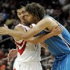 Photo -   Houston Rockets' Jeremy Lin, left, and New Orleans Hornets' Robin Lopez (15) hug after Lopez fouled Lin in the second half of a preseason NBA basketball game Friday, Oct. 12, 2012, in Houston. (AP Photo/Pat Sullivan)