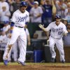 Kansas City Royals\' David Lough, left, celebrates as he scores the game-winning run off of an Alcides Escobar double in the ninth inning during a baseball game against the Baltimore Orioles, Wednesday, July 24, 2013, in Kansas City, Mo. The Royals won 4-3. (AP Photo/Ed Zurga)