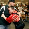 Lifter Ben Grubb gets a hug from his coach Shane Swords after Grubb\'s squat during the powerlifting competition for the Special Olympics at Oklahoma State University (OSU) on Wednesday, May 13, 2009, in Stillwater, Okla. Photo by Chris Landsberger, The Oklahoman