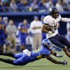 Photo - Utah State wide receiver Brandon Swindall runs past San Jose State cornerback Jimmy Pruitt after a catch during the first half of an NCAA college football game Friday, Sept. 27, 2013, in San Jose, Calif. (AP Photo/Marcio Jose Sanchez)