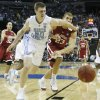 North Carolina\'s Tyler Hansbrought (50) and Oklahoma\'s Blake Griffin (23) battle for a loose ball during the first half in the Elite Eight game of NCAA Men\'s Basketball Regional between the University of North Carolina and the University of Oklahoma at the FedEx Forum on Sunday, March 29, 2009, in Memphis, Tenn. PHOTO BY CHRIS LANDSBERGER, THE OKLAHOMAN