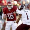 Oklahoma\'s Blake Bell (10) runs the ball around Texas A&M\'s Trent Hunter (1)during the college football game between the Texas A&M Aggies and the University of Oklahoma Sooners (OU) at Gaylord Family-Oklahoma Memorial Stadium on Saturday, Nov. 5, 2011, in Norman, Okla. Oklahoma won 41-25. Photo by Bryan Terry, The Oklahoman ORG XMIT: KOD