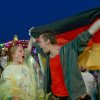 Photo - Soccer fans Daniel and Maryan celebrate as they watch the semifinal of the 2014 soccer World Cup between Brazil and Germany on the sidelines of the 'Bread & Butter' fair in Berlin, Tuesday evening, July 8, 2014.  (AP Photo/dpa, Britta Pedersen)