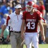 Bob Stoops talks with kicker Patrick O\'Hara (43) during the second half of the college football game between the University of Oklahoma Sooners (OU) and the Florida State University Seminoles (FSU) on Sat., Sept. 11, 2010, in Norman, Okla. Photo by Chris Landsberger, The Oklahoman