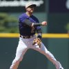 Photo - Colorado Rockies shortstop Troy Tulowitzki jumps in air to throw ball to first base to put out Los Angeles Dodgers leadoff hitter Dee Gordon in the first inning of a baseball game in Denver on Sunday, July 6, 2014. (AP Photo/David Zalubowski)