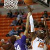 Oklahoma State\'s Toni Young (15) scores a basket over TCU\'s Natalie Ventress (24) during a women\'s college basketball game between Oklahoma State University and TCU at Gallagher-Iba Arena in Stillwater, Okla., Tuesday, Feb. 5, 2013. Oklahoma State won 76-59. Photo by Bryan Terry, The Oklahoman