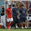 England\'s Alex Oxlade-Chamberlain (15) walks off the field after he was expelled in the second half of a friendly soccer match against Ecuador in Miami Gardens, Fla., Wednesday, June 4, 2014. The game ended in a 2-2 tie. (AP Photo/Alan Diaz)