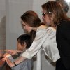 Photo -   In this April 11, 2012 photo released by The Los Angeles County Museum of Art, actress Angelina Jolie, center, sports an engagement ring as she and Brad Pitt, and their son, Pax view works from the Chinese collection at the The Los Angeles County Museum of Art, in Los Angeles. Pitt's manager Cynthia Pett-Dante confirmed their engagement on Friday April 13, 2012. (AP Photo/LACMA, Howard Pasamanick via PR Newswire) EDITORIAL USE ONLY
