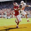 OU\'s Kenny Stills (4) catches a touchdown pass in the first quarter as Kenny Vaccaro (16) of Texas defends during the Red River Rivalry college football game between the University of Oklahoma Sooners (OU) and the University of Texas Longhorns (UT) at the Cotton Bowl on Saturday, Oct. 2, 2010, in Dallas, Texas. Photo by Nate Billings, The Oklahoman