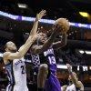Sacramento Kings\' Tyreke Evans (13) goes to the basket between Memphis Grizzlies\' Tayshaun Prince (21) and Mike Conley (11) during the first half of an NBA basketball game in Memphis, Tenn., Tuesday, Feb. 12, 2013. (AP Photo/Danny Johnston)