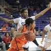 Photo - Tiffany Bias of Oklahoma State tries to take the ball past TCU's Chelsea Prince during an NCAA basketball game, Wednesday, Jan. 29, 2014 in Fort Worth, Texas. (AP Photo/The Fort Worth Star-Telegram, Ron T. Ennis)