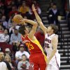 Houston Rockets forward Chandler Parsons (25) is challenged by Atlanta Hawks guard Kyle Korver (26) on a shot during the first half of an NBA basketball game, Monday, Dec. 31, 2012, in Houston. (AP Photo/Bob Levey)